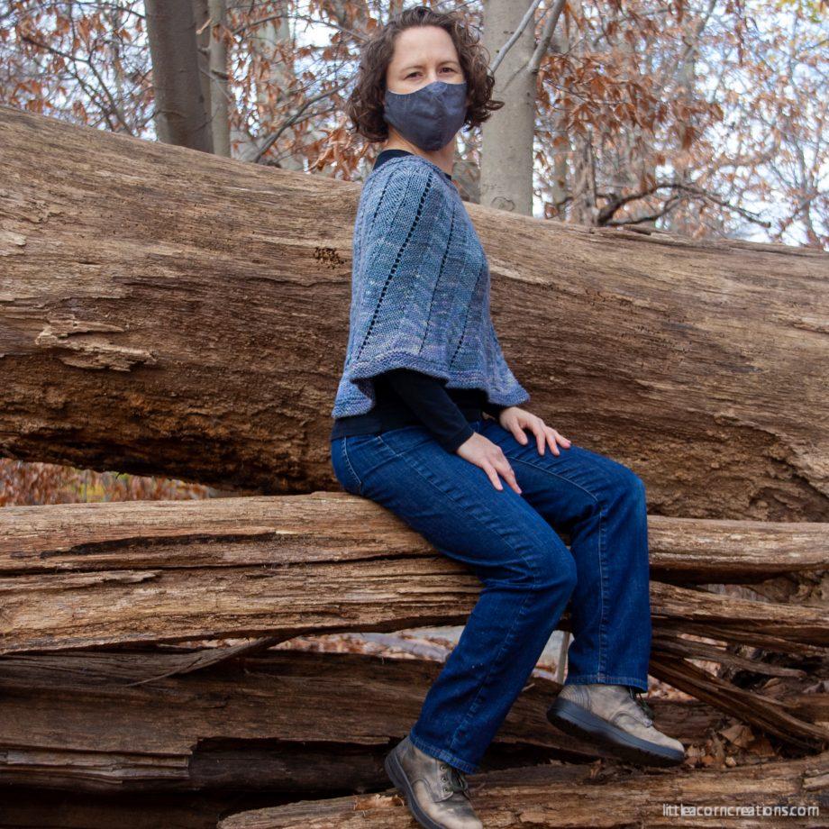 covid-era masked woman wearing ayrton sitten on a fallen tree