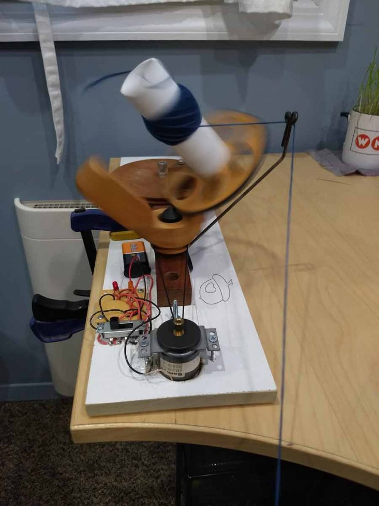 First run of the ball winder using a hair tie and 9V battery