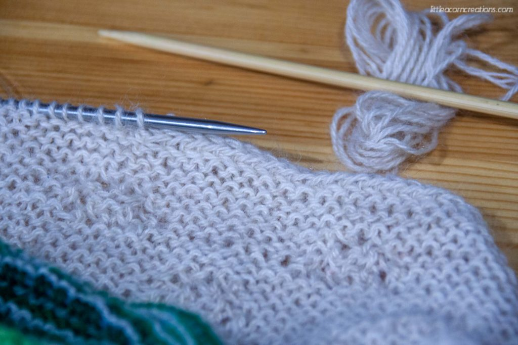 Unpicking i-cord bind-off of the Upper Triangle for the High Sierra Shawl.